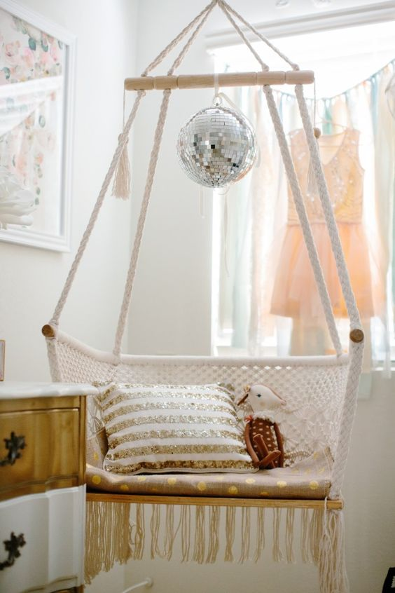 a hammock chair topped with a disco ball