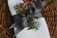 03 a napkin topper with holly and evergreens, an elgant bow