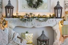 03 a sophisticated lit up mantel decorated with pinecones and evergreen branches