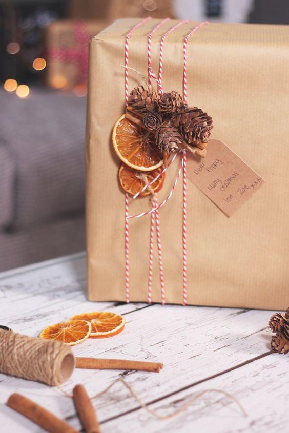 kraft paper, black and white yarn, dried citrus, cinnamon sticks and pinecones