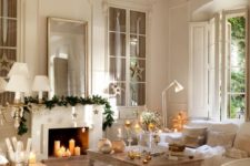 04 a mantel can become a focal point if you decorate it right – an evergreen garland and stars hanging