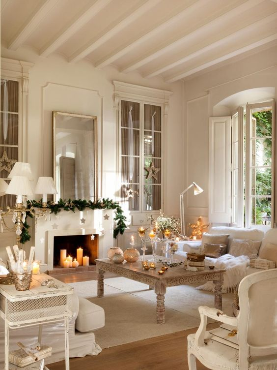 a mantel can become a focal point if you decorate it right - an evergreen garland and stars hanging