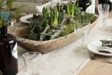04 a wooden bowl with moss and bulbs is a perfect centerpiece for a rustic table setting