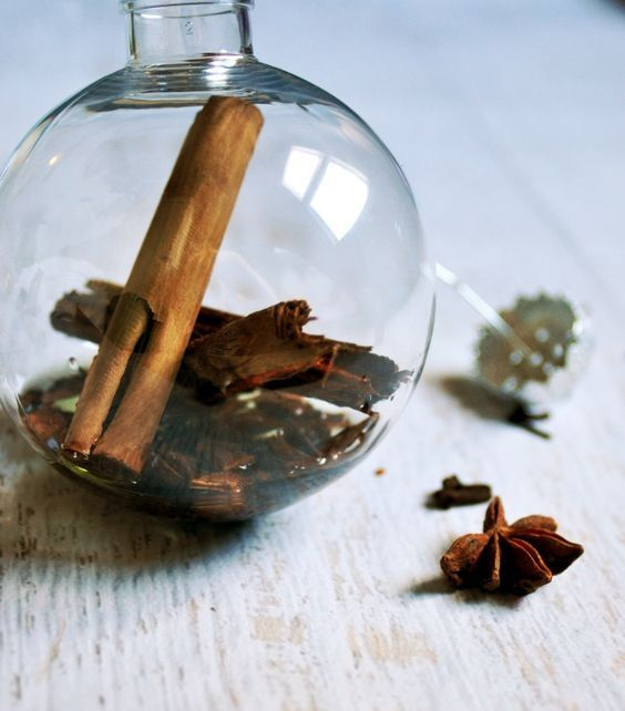 fill a glass christmas ornament with whole spices, some grapeseed oil and essential oils orange, cinnamon for a perfect scent