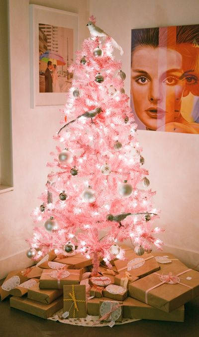 lit up pink Christmas tree with ivory and silver ornaments