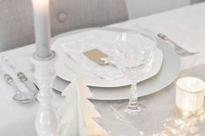 04 white Christmas table setting with lights, stars and candles
