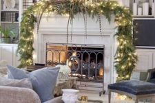 05 a lit up garland and wreath will easily turn your mantel into a Christmas one