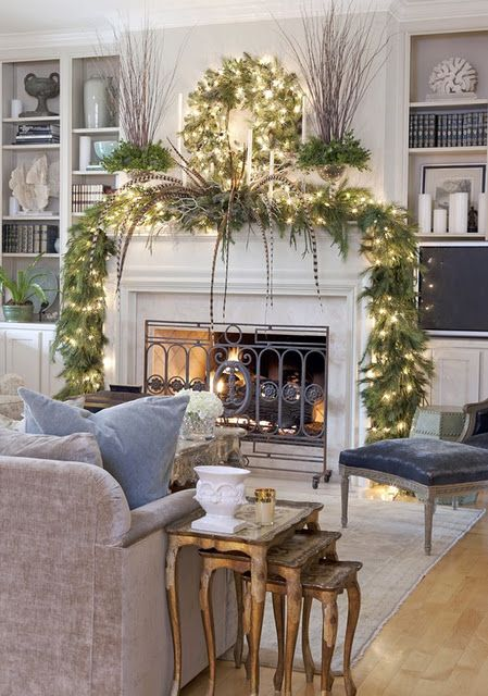 a lit up garland and wreath will easily turn your mantel into a Christmas one