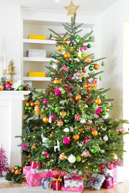 a usual christmas tree decorated in orange raspberry and sage colors - Colorful Christmas Decorations