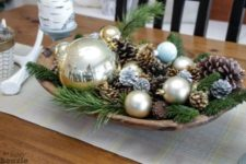 05 a wooden bowl with pinecones, ornaments and greenery