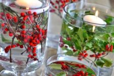 05 easy holly centerpiece in a glass vase with floating candles