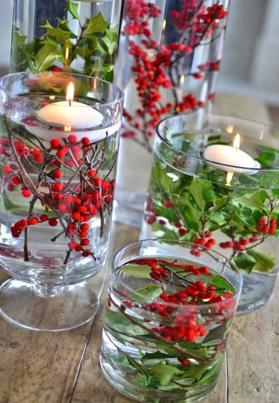 easy holly centerpiece in a glass vase with floating candles - Christmas Holly Decorations