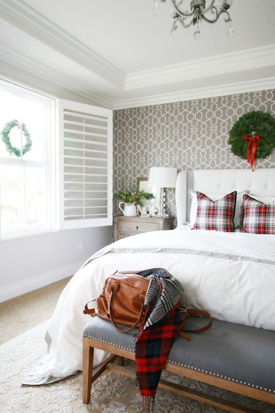 keep it simple hanging a coupel of evergreen wreaths in your bedroom