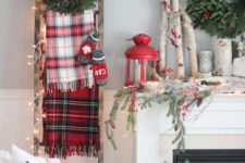 05 rustic mantel with branches, a red lantern and evergreens
