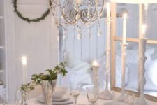 05 vintage-inspired table setting with silver vases and greenery