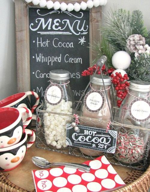 a hot cocolate bar wwith a chalkboard sign and a wire basket
