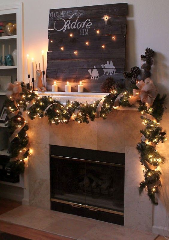 a reclaimed pallet wood sign and burlap garland with lights