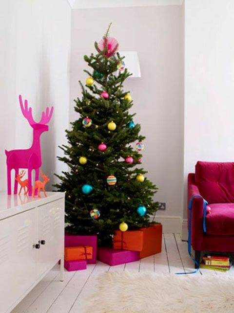 a usual tree with colorful baubles looks cheerful