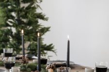 06 evergreen table runner with nuts, black candles and pinecones