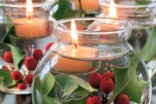 06 make cool centerpiece of jars with floating candles and holly sprigs