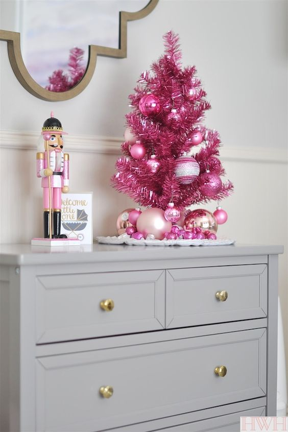 a bold tabletop pink tree with ornaments will be a cute idea for your daughter's room