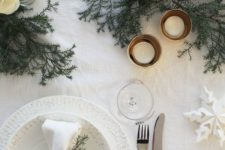 07 beautiful white table wwith evergreens, paper snowflakes and candles