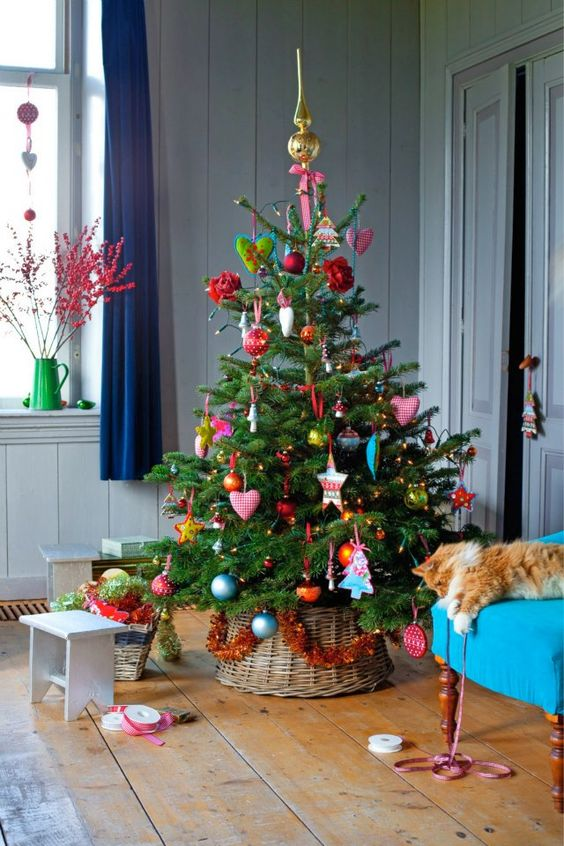 bold decor of a small tree looks eclectic and cheerful