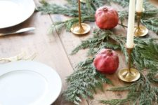 07 evergreen table runner with candles and pomegranates