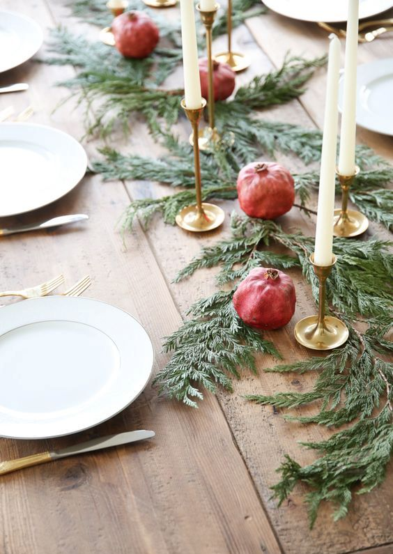evergreen table runner with candles and pomegranates