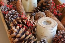 07 fill a dough bowl with pinecones, berries and candles for a simple rustic look