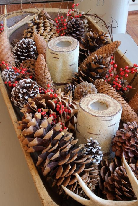 fill a dough bowl with pinecones, berries and candles for a simple rustic look