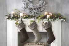 07 fir branches, lights, pinecones and stockings, a snowy white wreath over the fireplace
