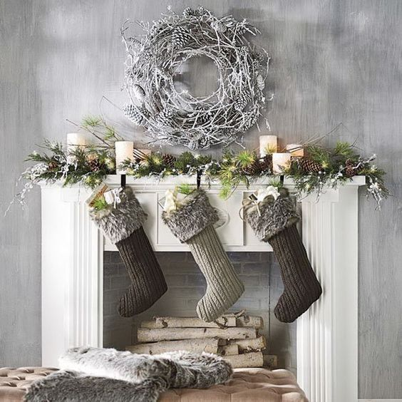 fir branches, lights, pinecones and stockings, a snowy white wreath over the fireplace
