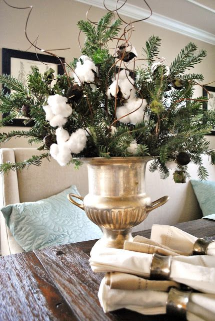 incorporate cotton into evergreen displays for a cozy look