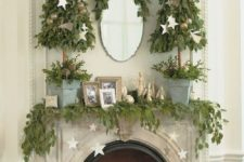 07 leaf garland with gold stars hanging and leaf Christmas trees in buckets