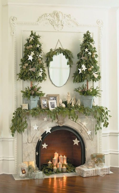 leaf garland with gold stars hanging and leaf Christmas trees in buckets