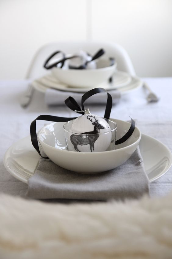 minimal monochrome tablescape with a fur tablecloth, black and white ornaments