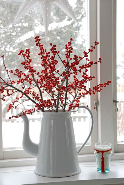 an old coffee pot with red berries will be a great centerpiece