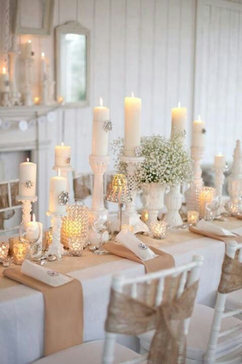 charming white vintage tablescape with baby's breath and candles