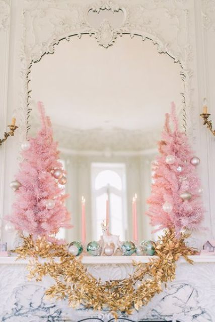 small pink christmas trees with gold holiday garland for mantel decor
