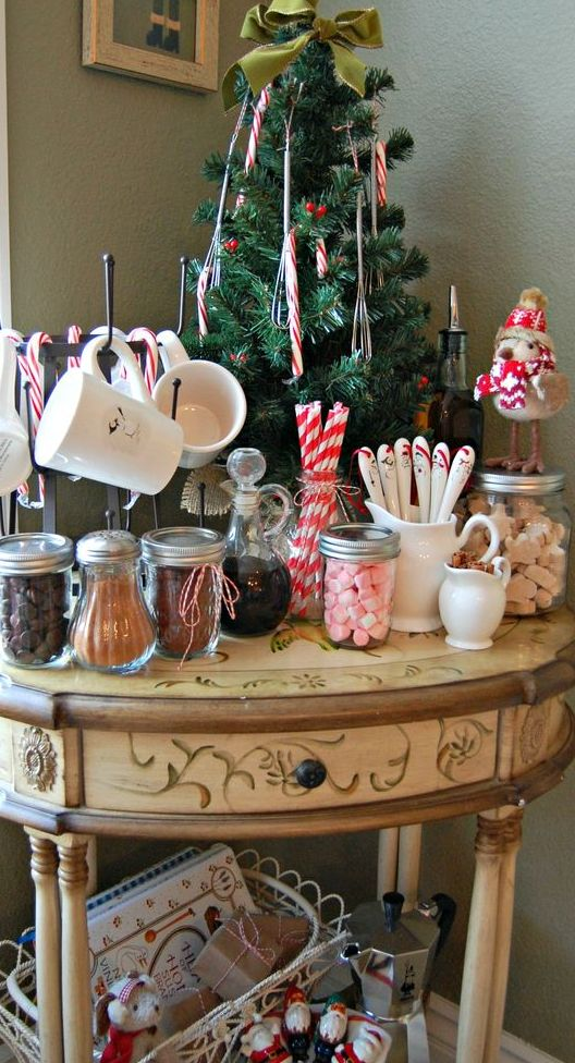 a vintage hot cocoa station displayed on an antique table