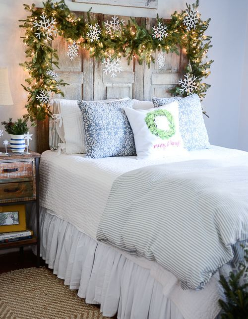 chic fir garland with lights and white snowflakes over the bed