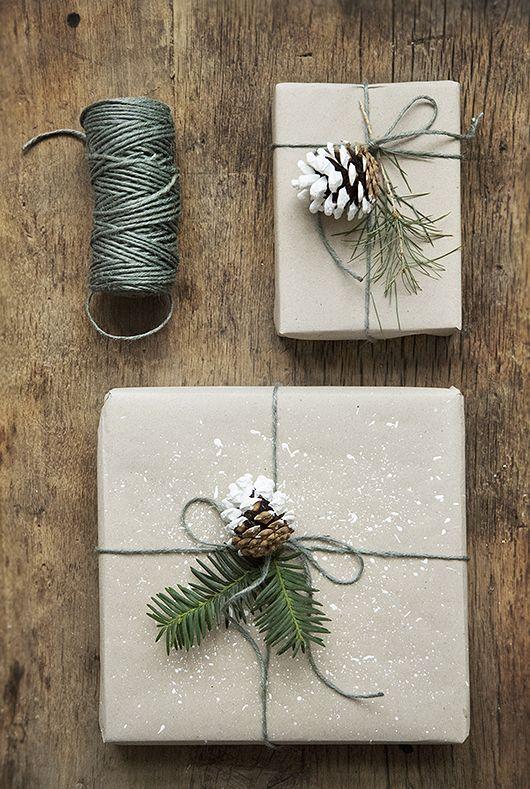 kraft paper, green yarn, evergreen twigs and snowy pinecones