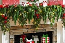 09 lush evergreen garland with lights and ornaments, small gift boxes on stands