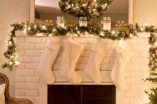 10 a garland and a wreath with lights, cozy white stockings
