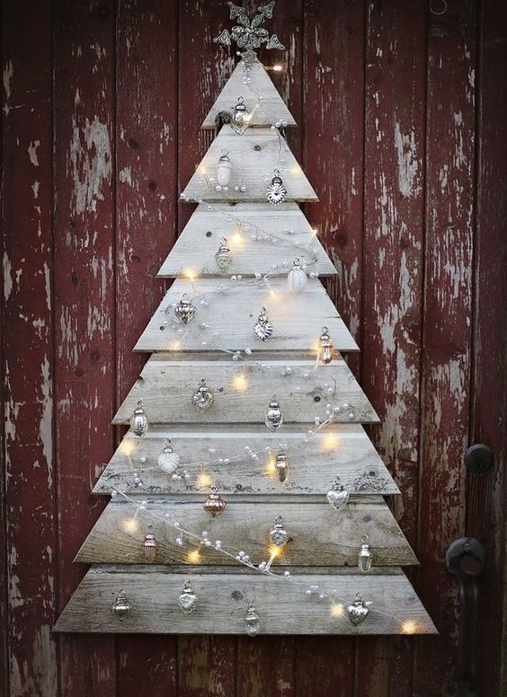 beautiful grey pallet plank tree with silver ornaments and lights