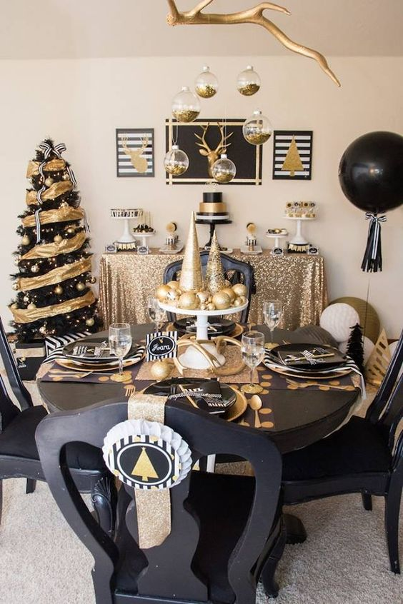 black and gold tablescape looks refined with gold and glitter ornaments & 21 Modern Christmas Table Settings To Get Inspired - Shelterness