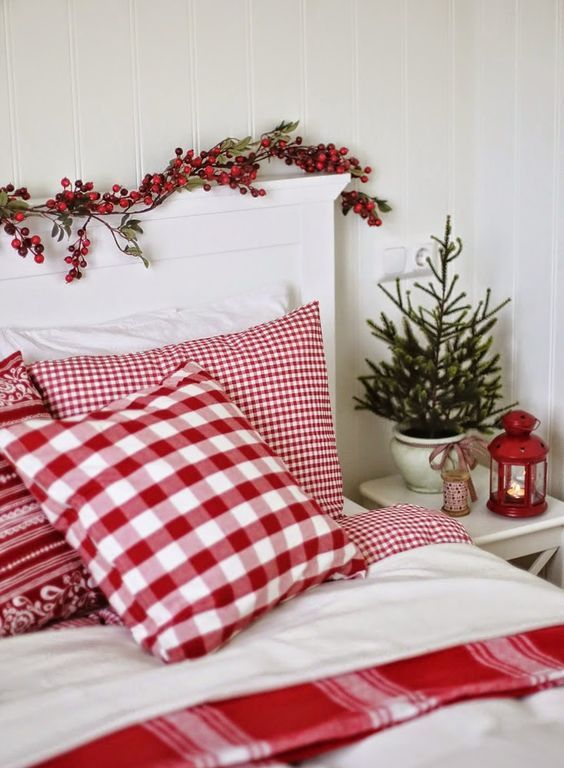 red and white Scandi-style bedding echoes with berries on the headboard