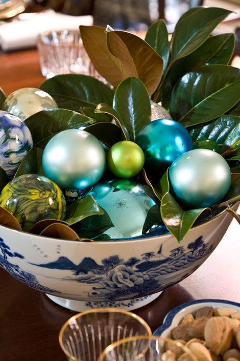 a chinoiserie bowl with ornaments and leaves inside