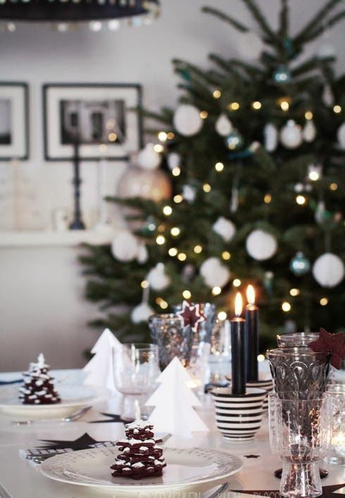 black and white table decor with black candles and cookies
